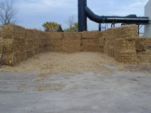 Bales of corn stover to be shredded for use in test burn