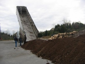 A load of turkey litter being delivered for use in test burn for Xcel Energy
